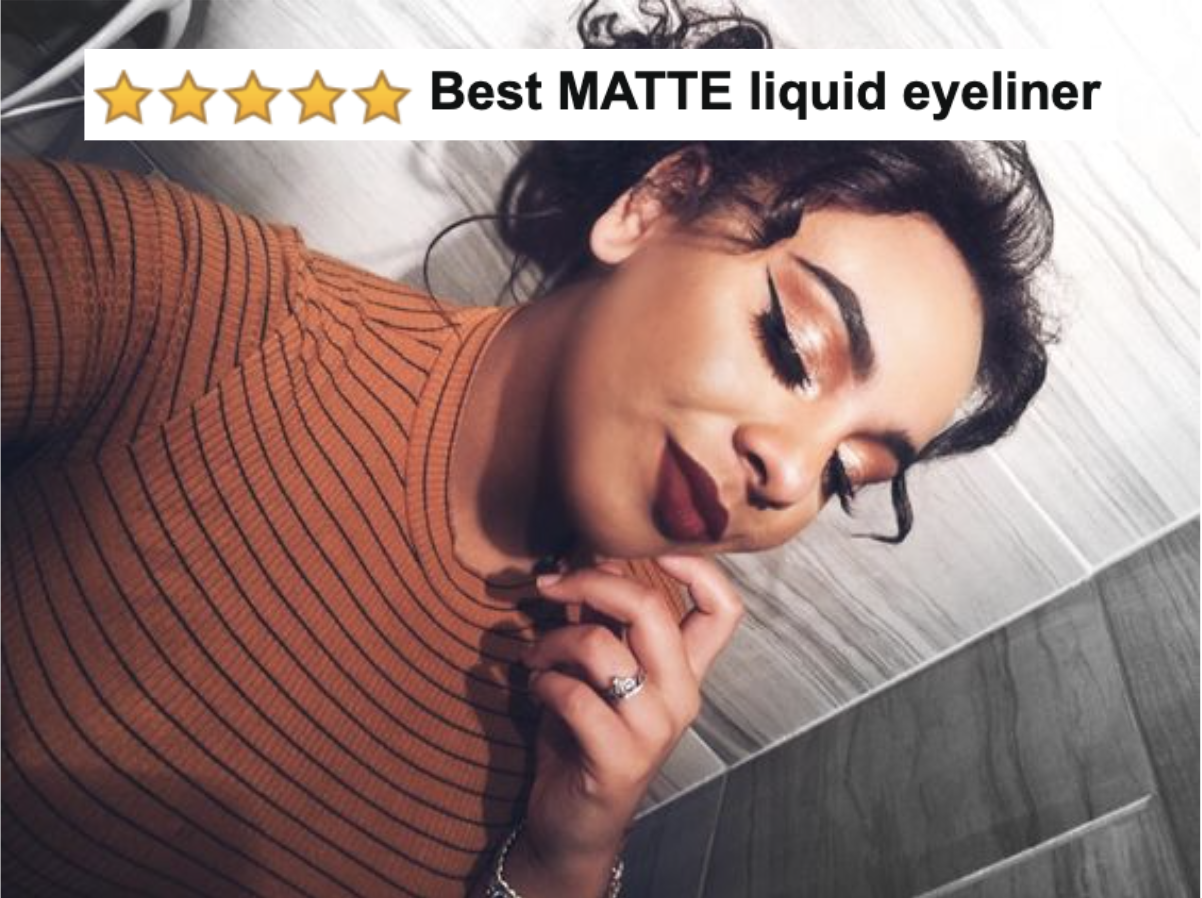 """A reviewer photo wearing a winged black liquid eyeliner with five-star caption """"best matte liquid eyeliner"""""""