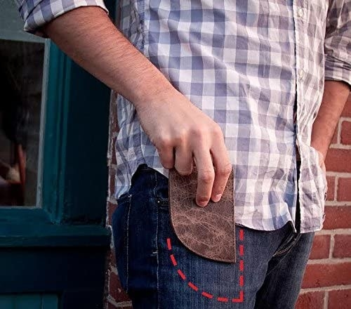 The curved wallet sliding into a pocket
