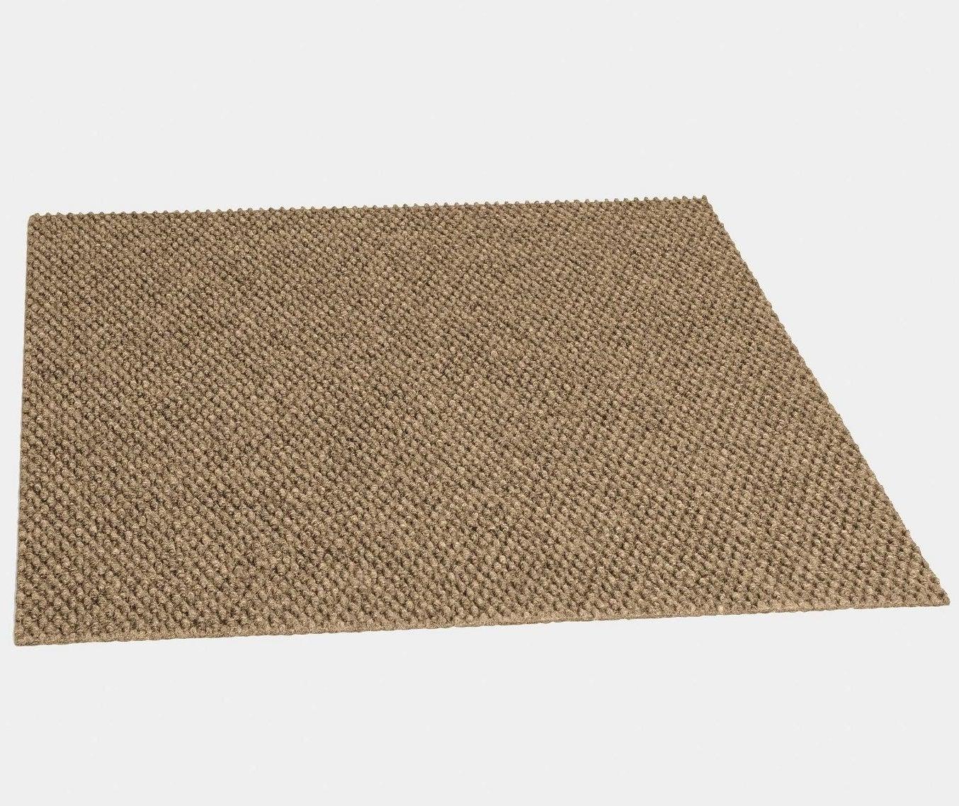 a single chestnut hobnail self-stick carpet tile