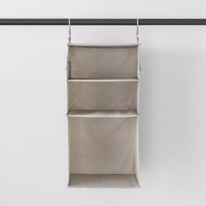 Closet organizer hanging on rod