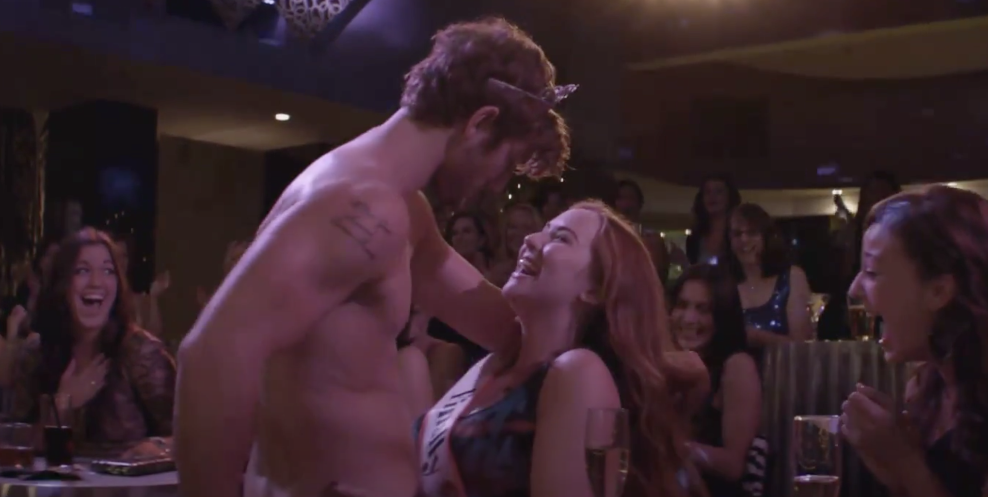 "Alex Pettyfer doing his first routine in ""Magic Mike"" with a woman onstage"