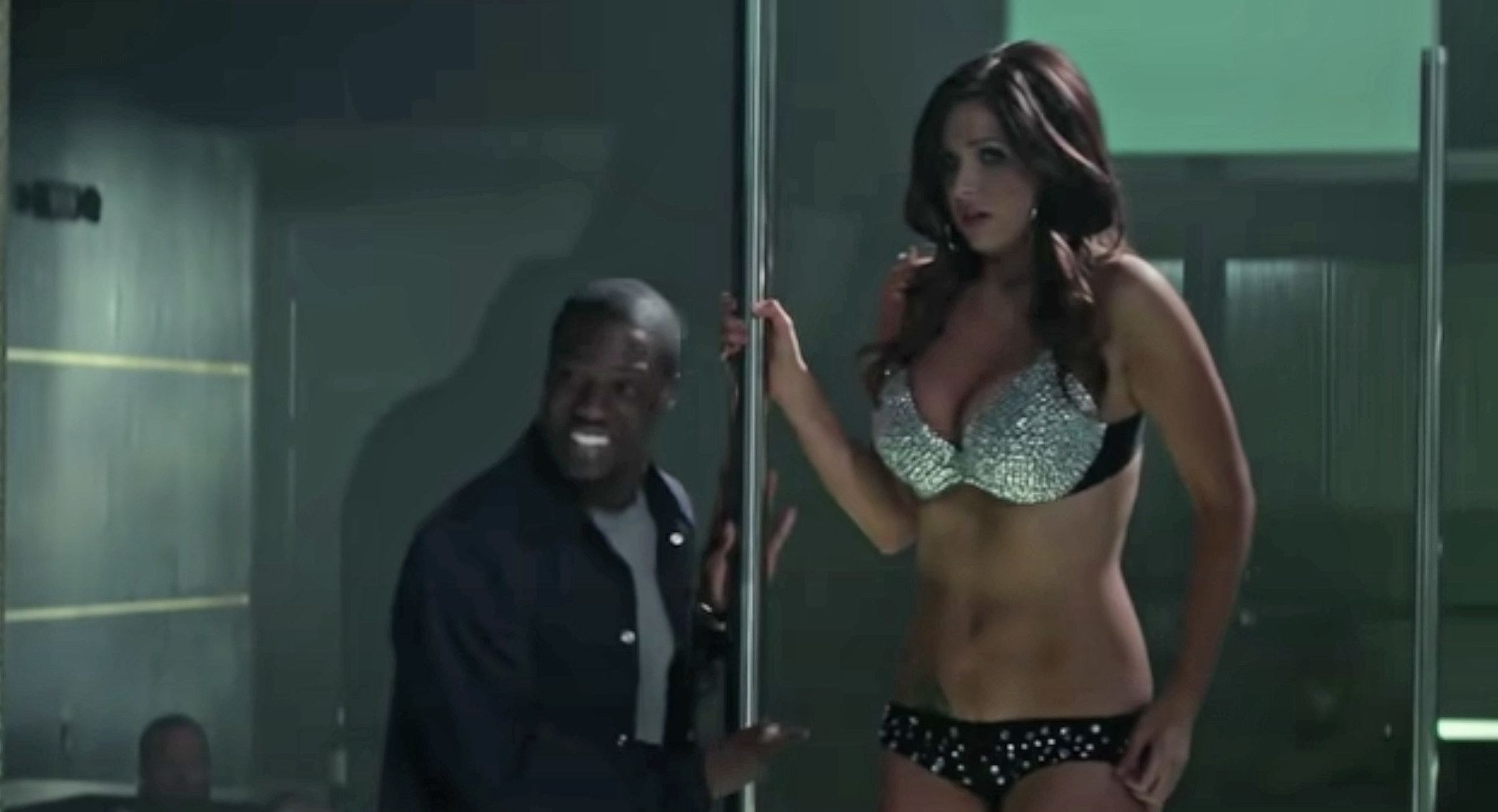 "A stripper and Kevin Hart in ""Ride Along"""