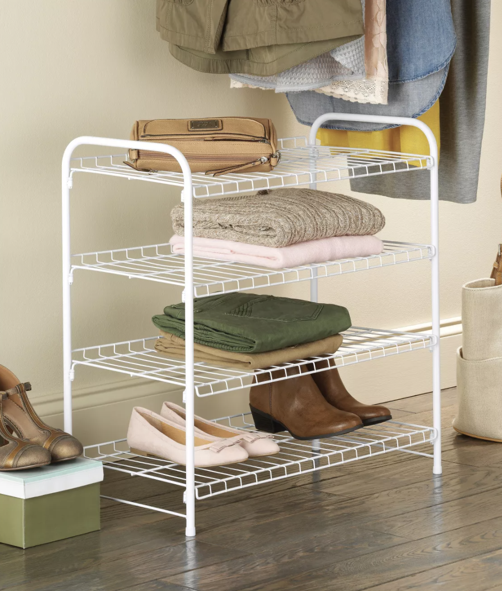 Wire rack with shoes and clothes placed on top