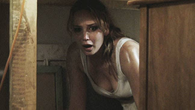 Jennifer Lawrence looking at something with a scared look on her face