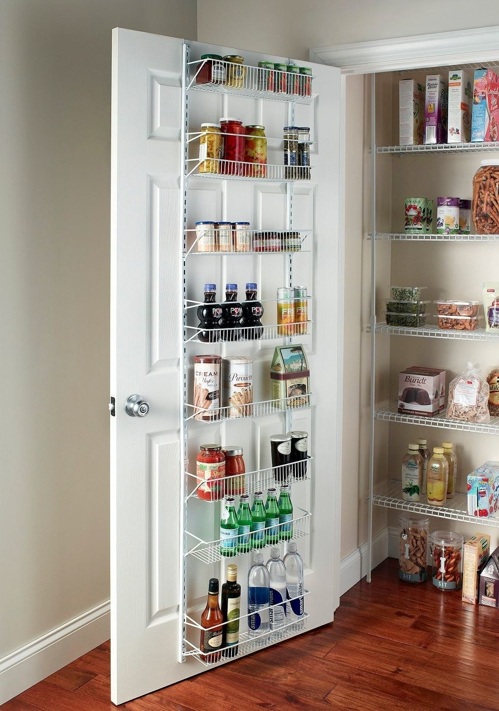 the ClosetMaid 8 tier adjustable wire rack hanging over a pantry door with food stuffs in each of its tiers