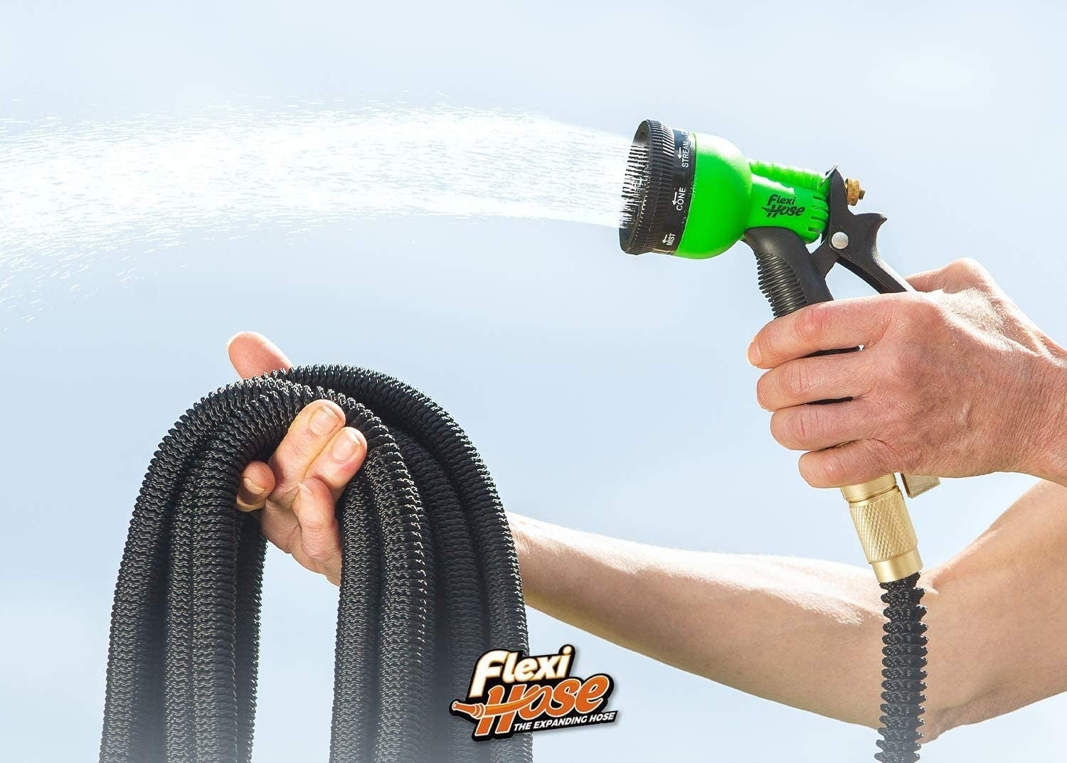 hand holds pile of hose with a spray nozzle
