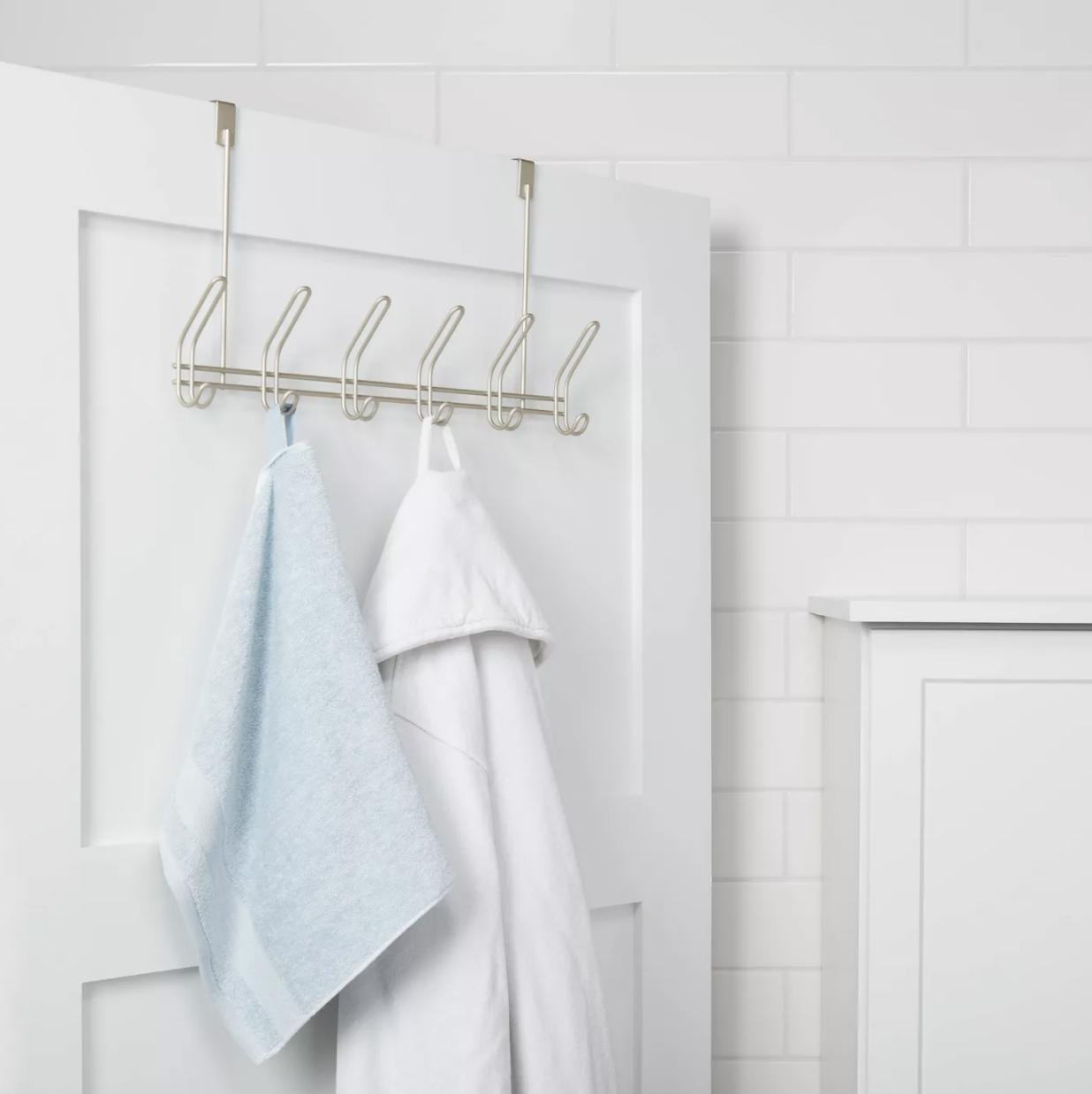 Towels hanging on over-the-door hooks