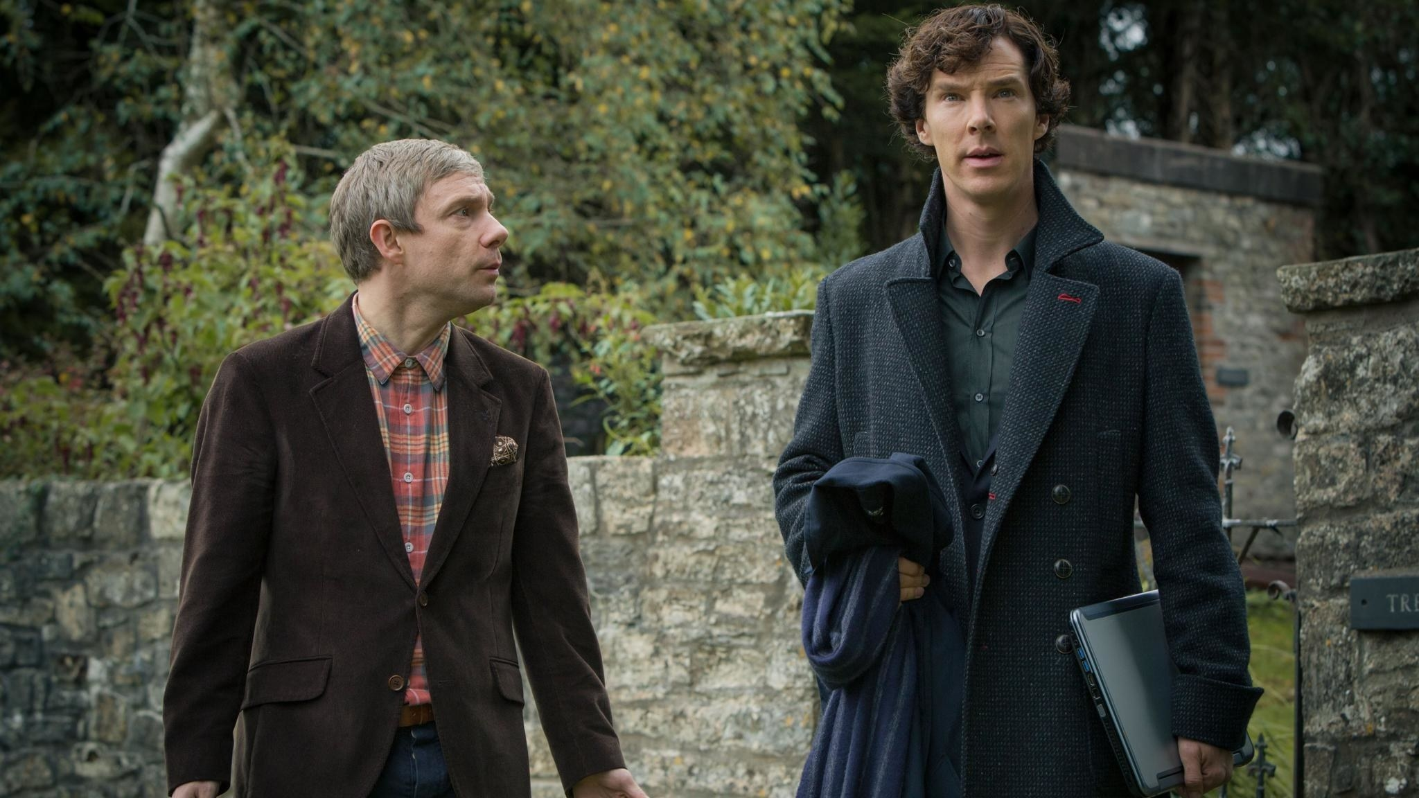 Sherlock Holmes and Watson walking and having a discussion