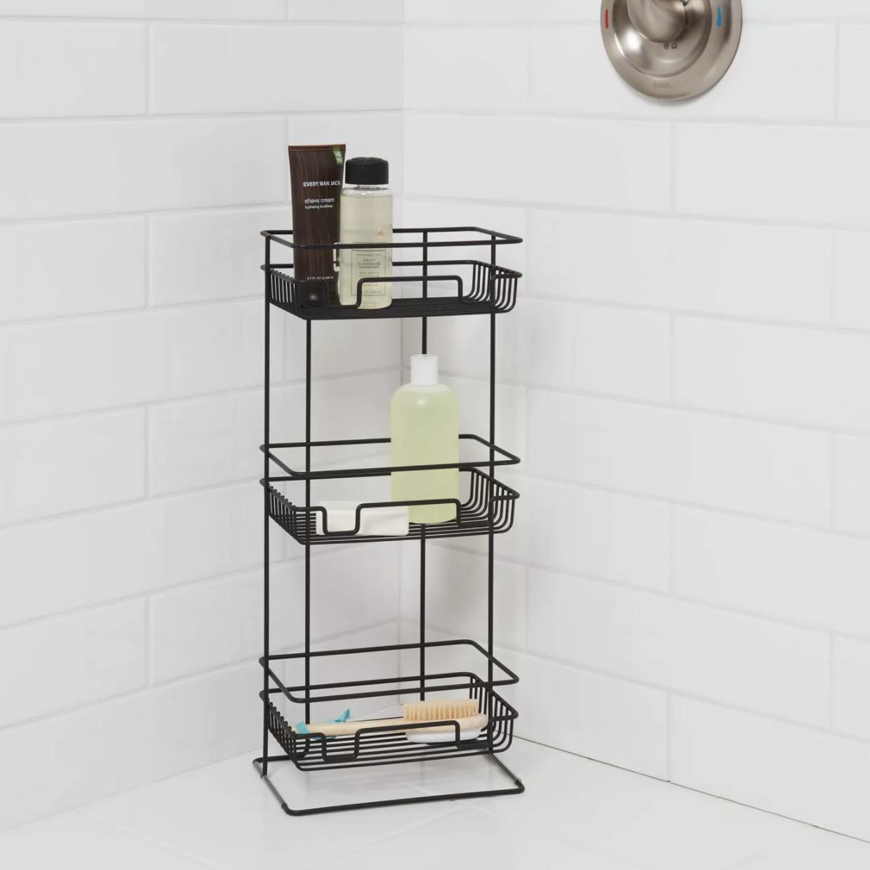 Three shelf organizer placed on shower floor
