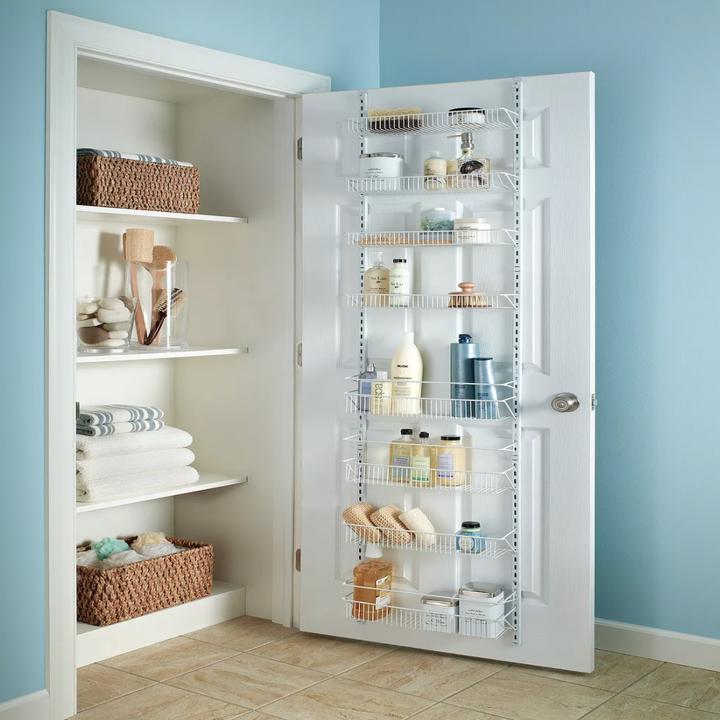 Organizing rack placed over linen closet door