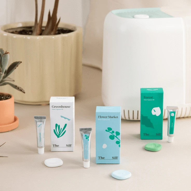 white humidifier with three little tubes of fragrance