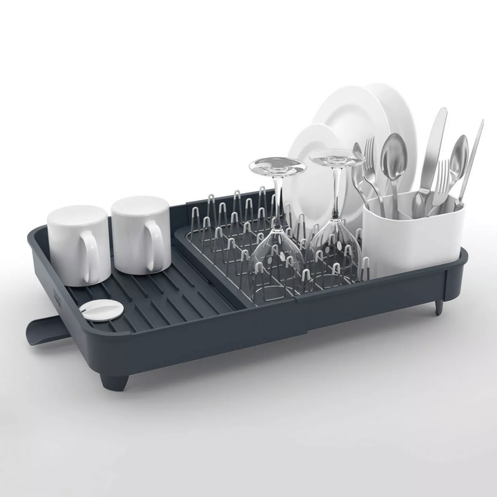Dish drying rack with plates and utensils inside