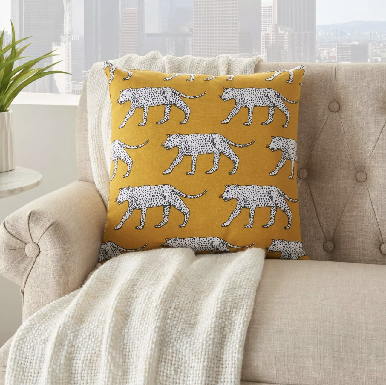 Yellow pillow styled on couch