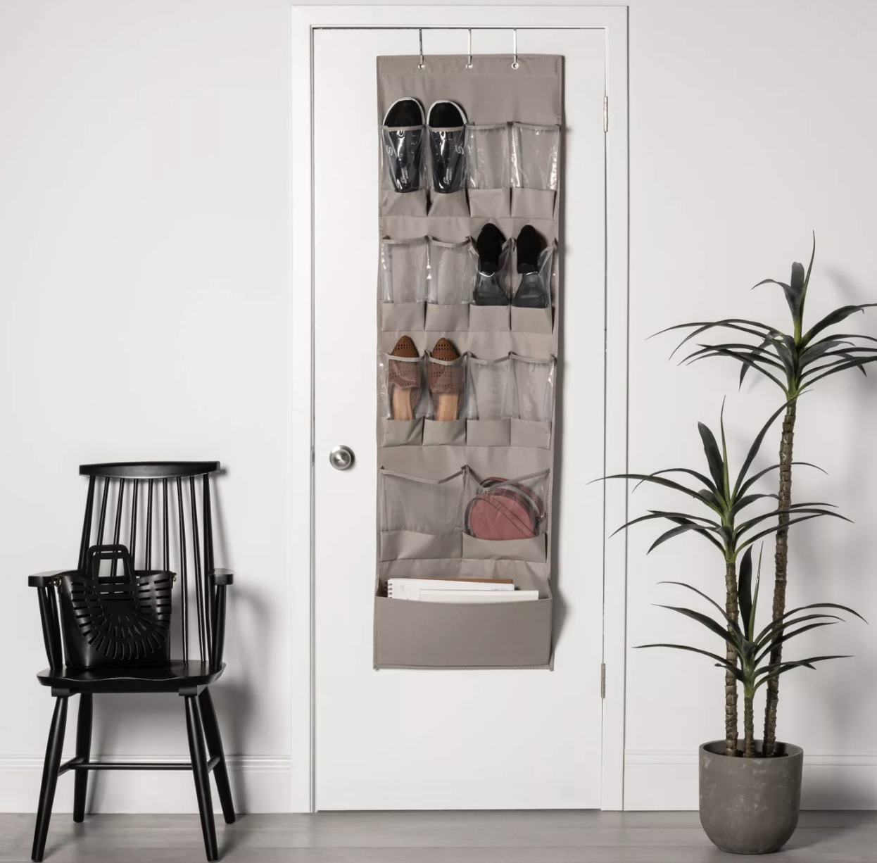 Over-the-door organizer with shoes and various items placed inside