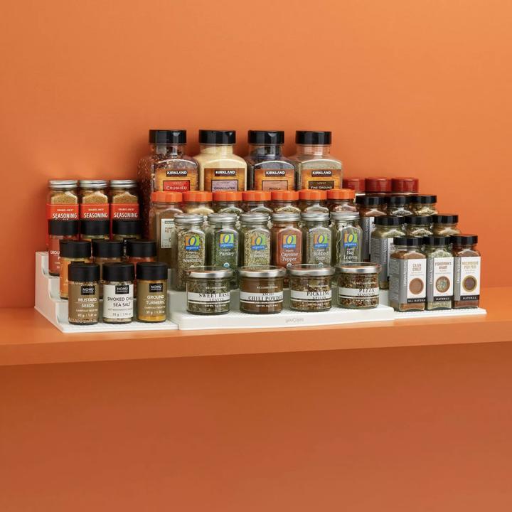 Spices placed on three-piece shelf unit