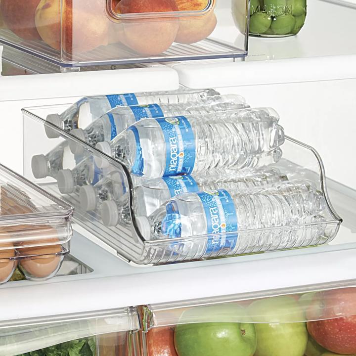 Water bottles placed in clear bottle organizer