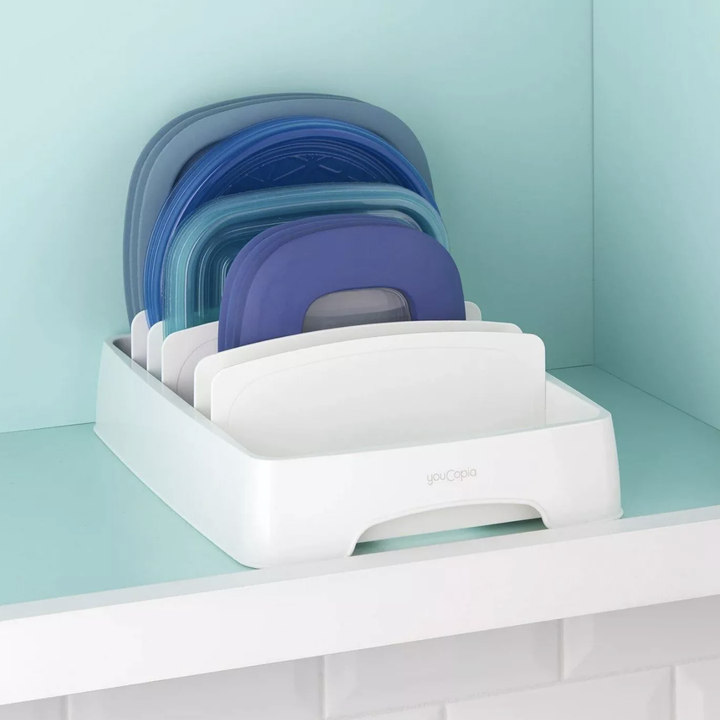 Lid storage organizer with various lids placed inside