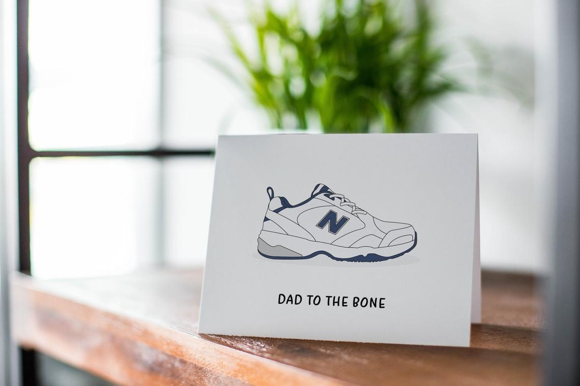 """the white card has a new balance shoe on it and says """"dad to the bone"""""""
