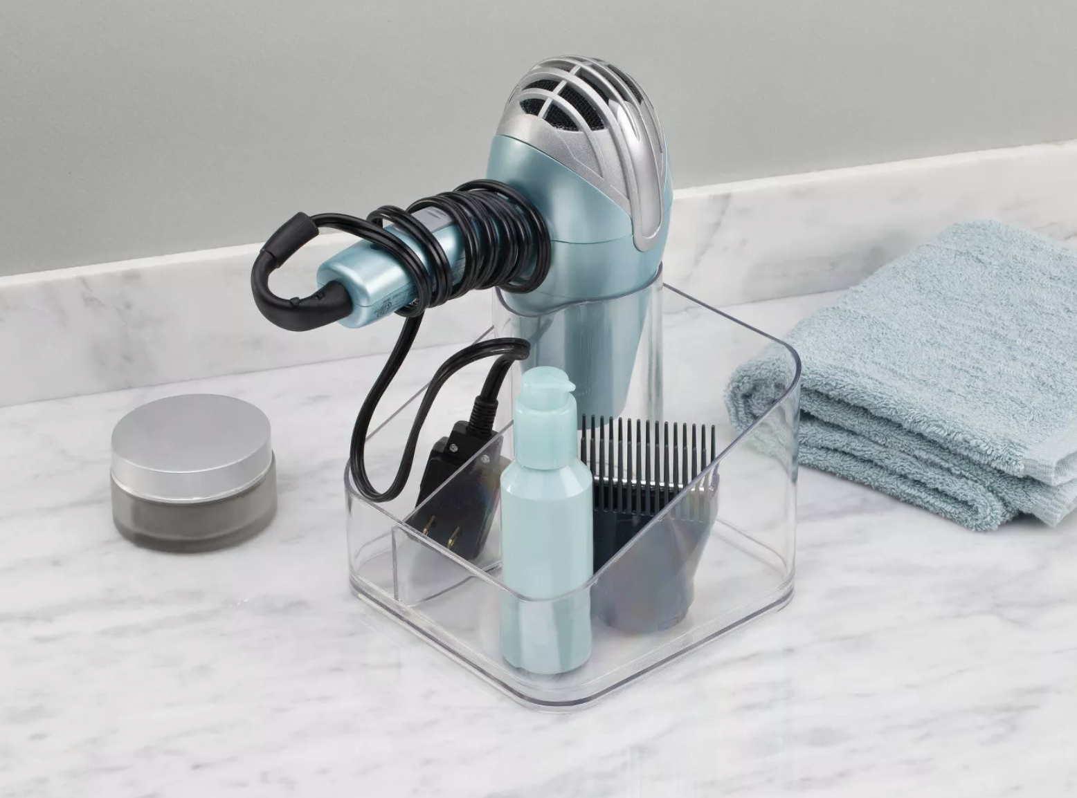 Hair dryer and various accessories placed in bathroom organizer