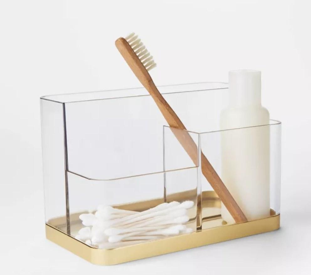 The vanity organizer in gold