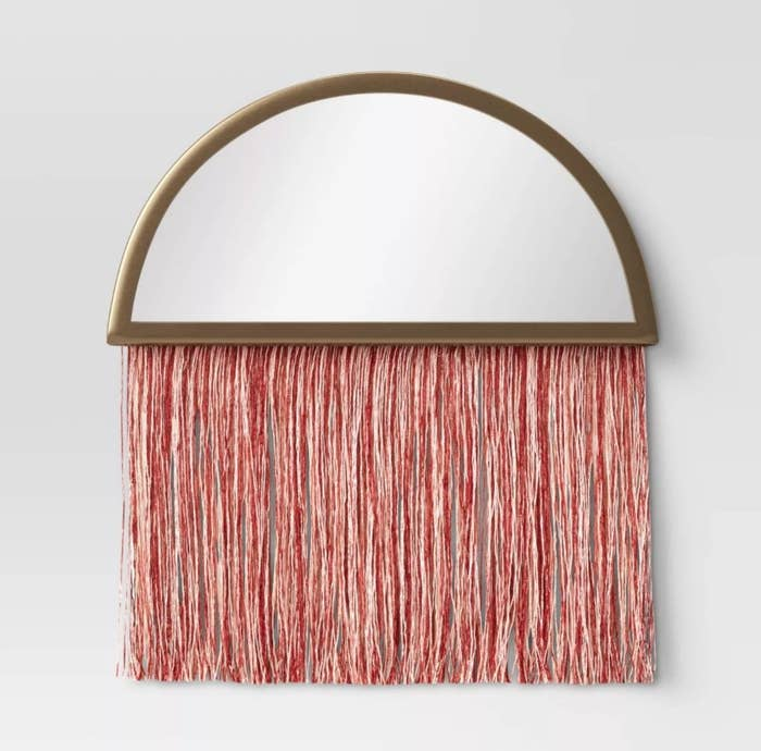 The macrame mirror on the wall
