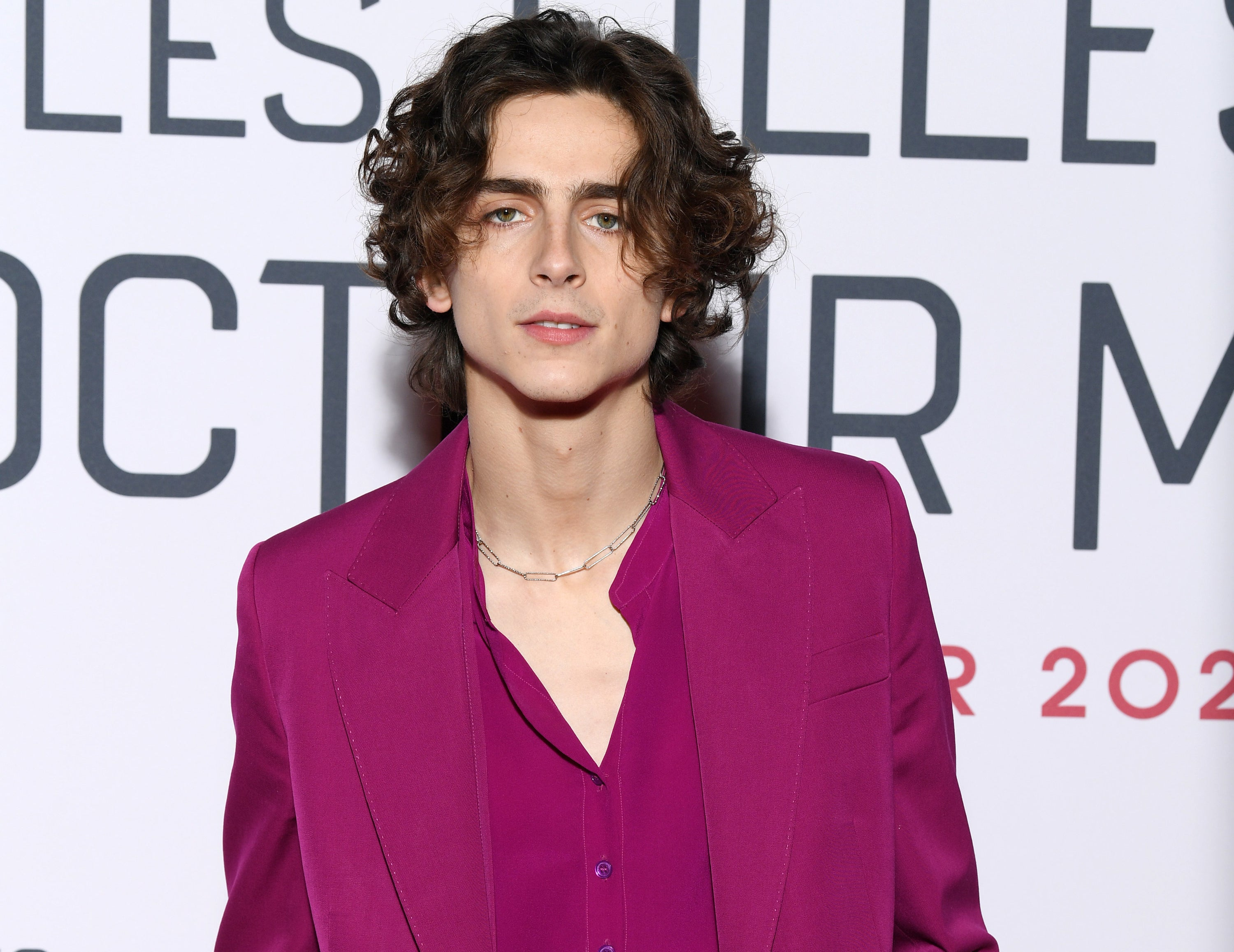 Timothee wears a pink suit while attending an even