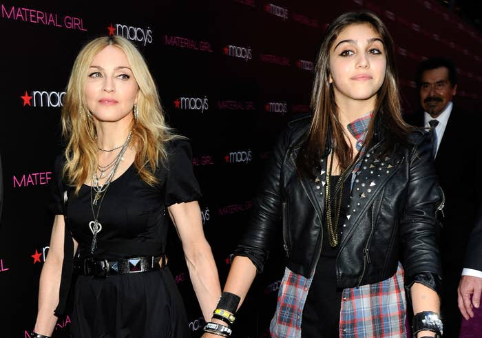 Madonna holds hands with Lourdes at an appearance for their fashion line