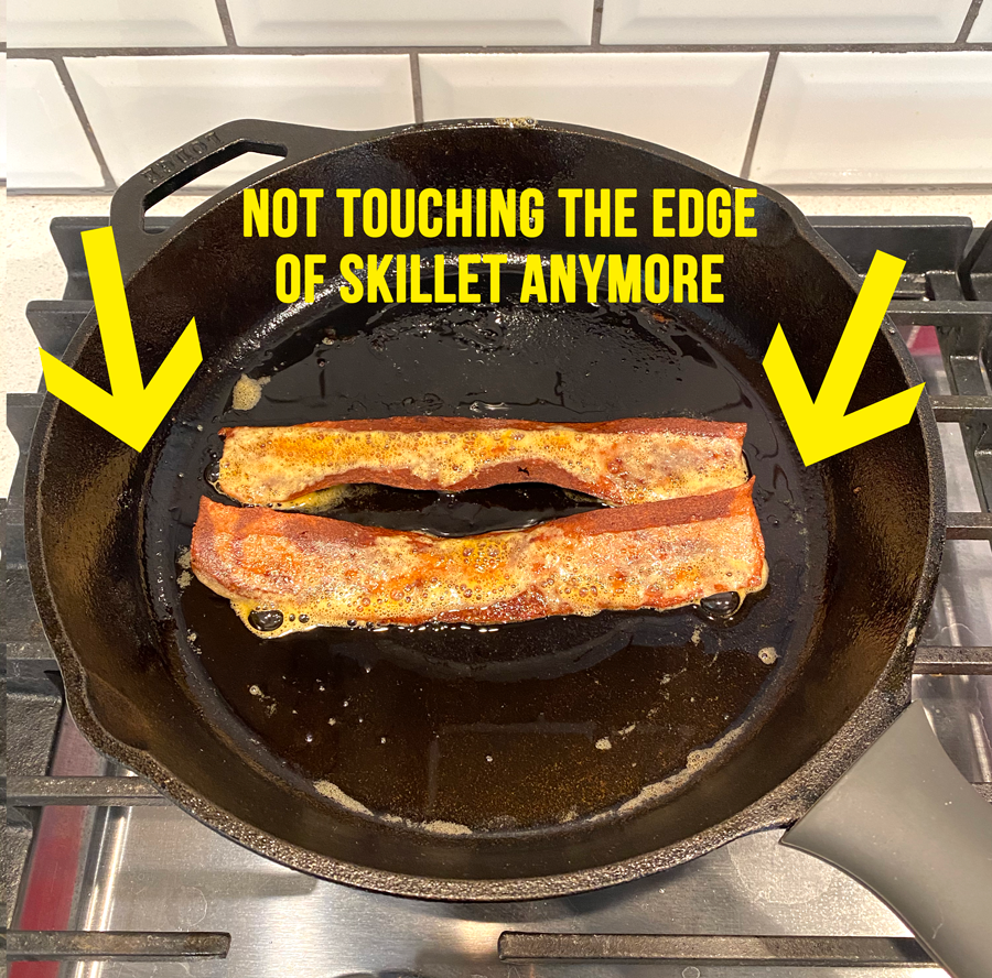 Bacon has shrunk down and not touching the edge of the skillet anymore