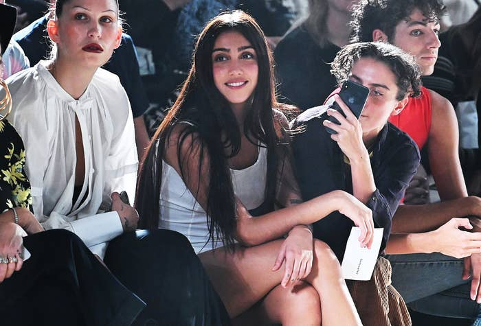 Lourdes smiles while attending a fashion show