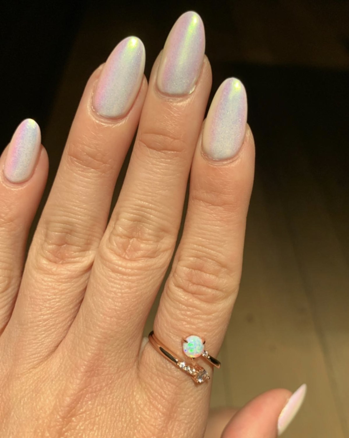 an opal wrap around ring with gold metal