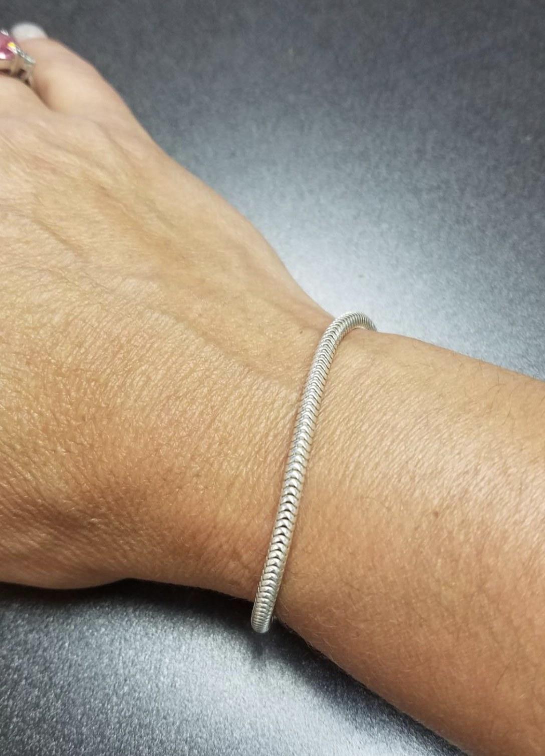 a silver bracelet on a person's wrist