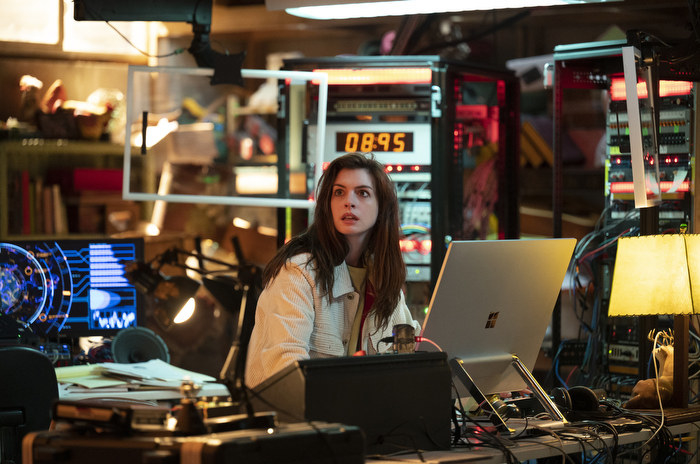 Anne Hathaway sits in front of a computer in the Amazon series Solos