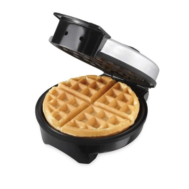 The waffle maker, which has a stainless steel casing