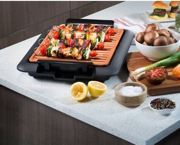 The electric grill, which is small enough to sit on a kitchen counter and has an open grill area with no cover