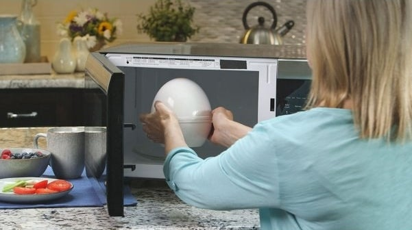 The egg cooker, which is shaped like a very large plastic egg and which is placed into the microwave