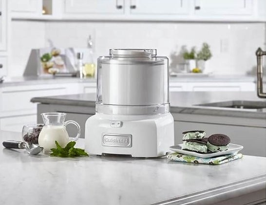 The ice cream maker, which sits on the countertop, in white