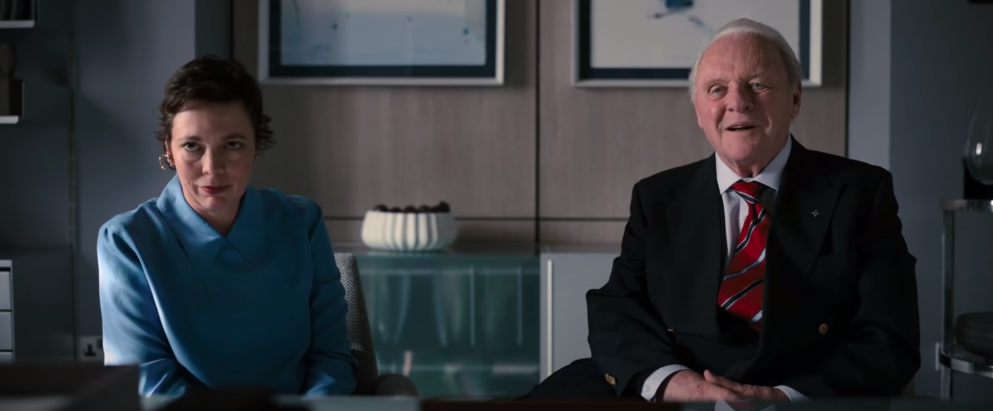 """Olivia Coleman and Anthony Hopkins sitting in an office in """"The Father"""""""