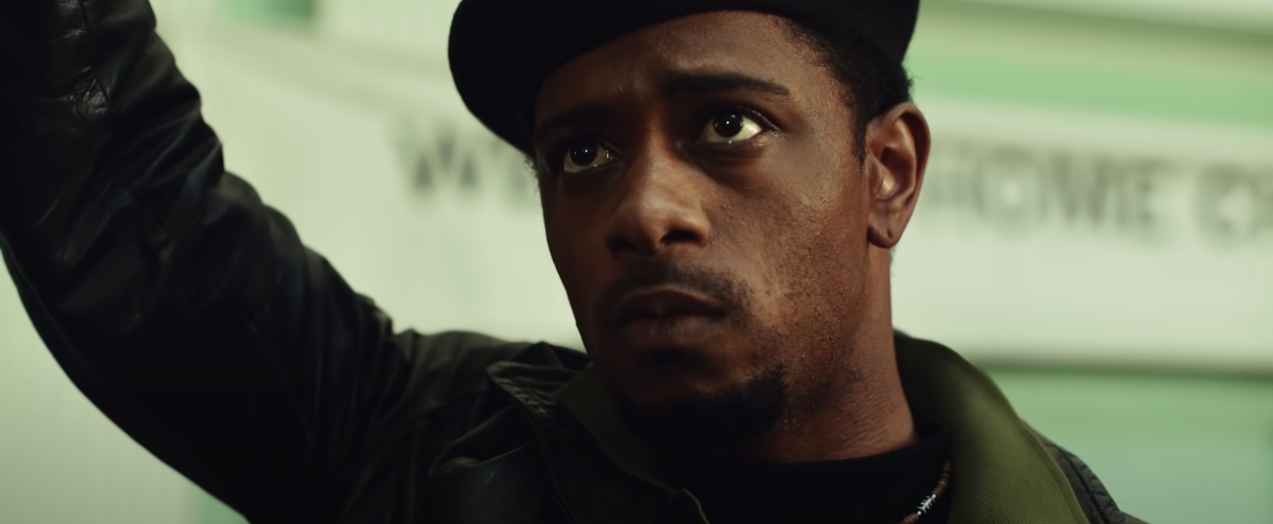"""LaKeith Stanfield raisins his fist in """"Judas and the Black Messiah"""""""
