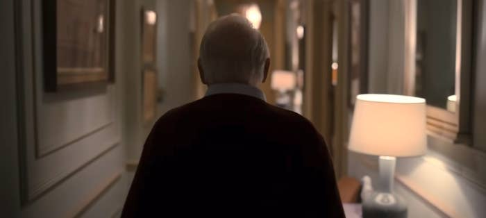 """Anthony Hopkins walking down a hallway in """"The Father"""""""