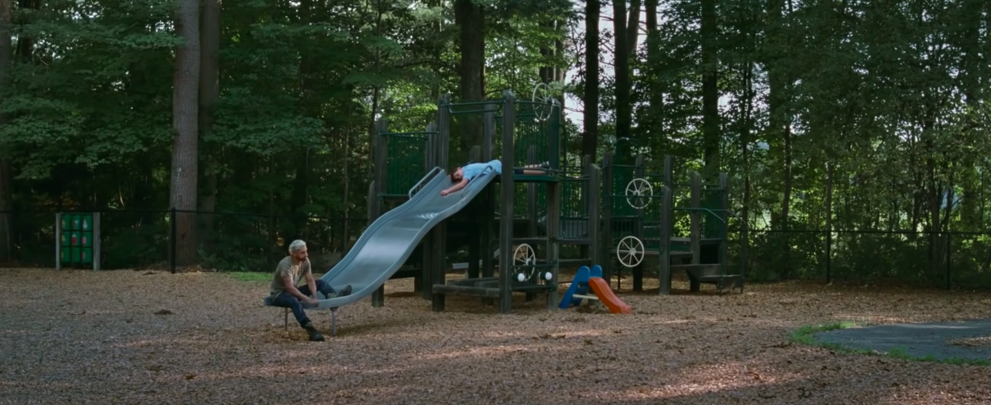 """Riz Ahmed and a child on a slide in """"Sound of Metal"""""""