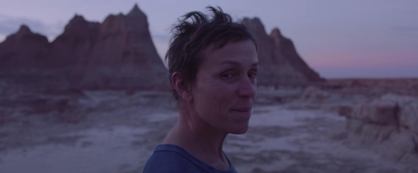 """Frances McDormand smiling in """"Nomadland"""""""