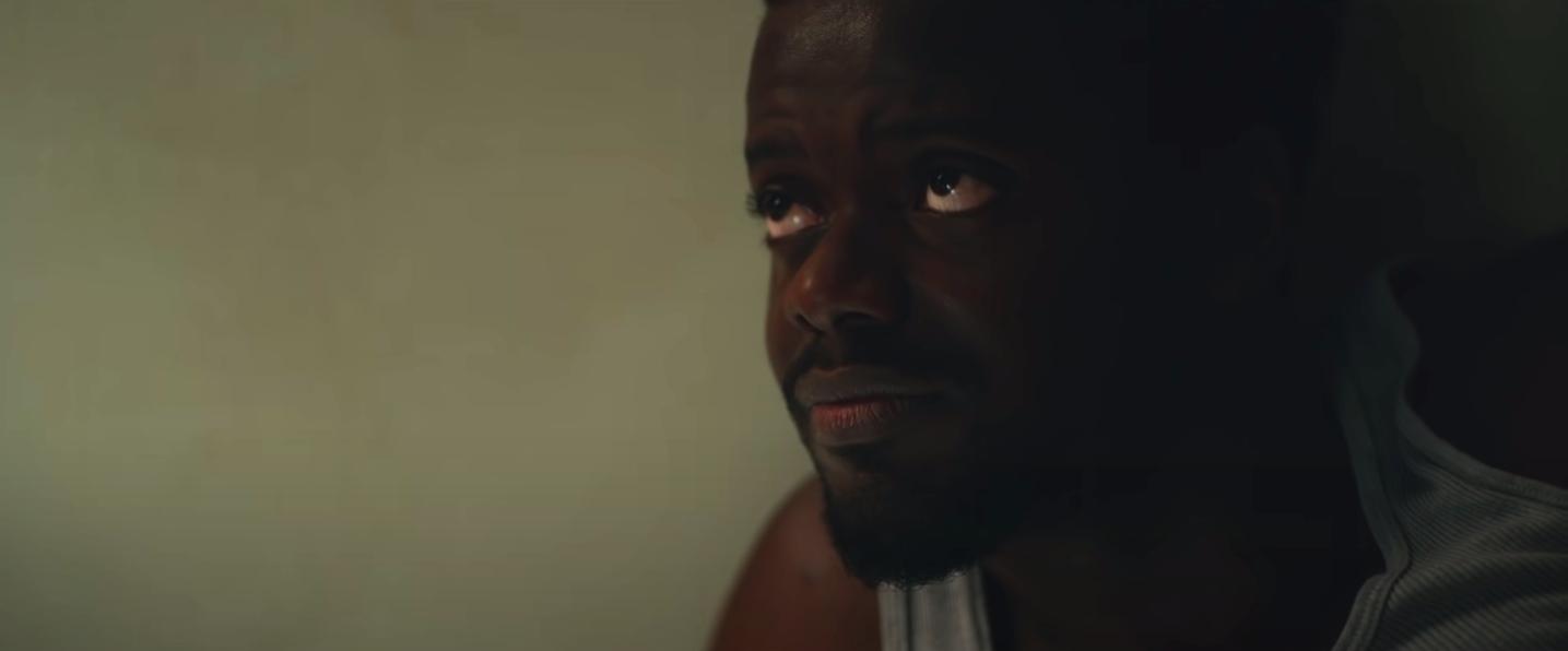 "Daniel Kaluuya looking at someone warmly in ""Judas and the Black Messiah"""