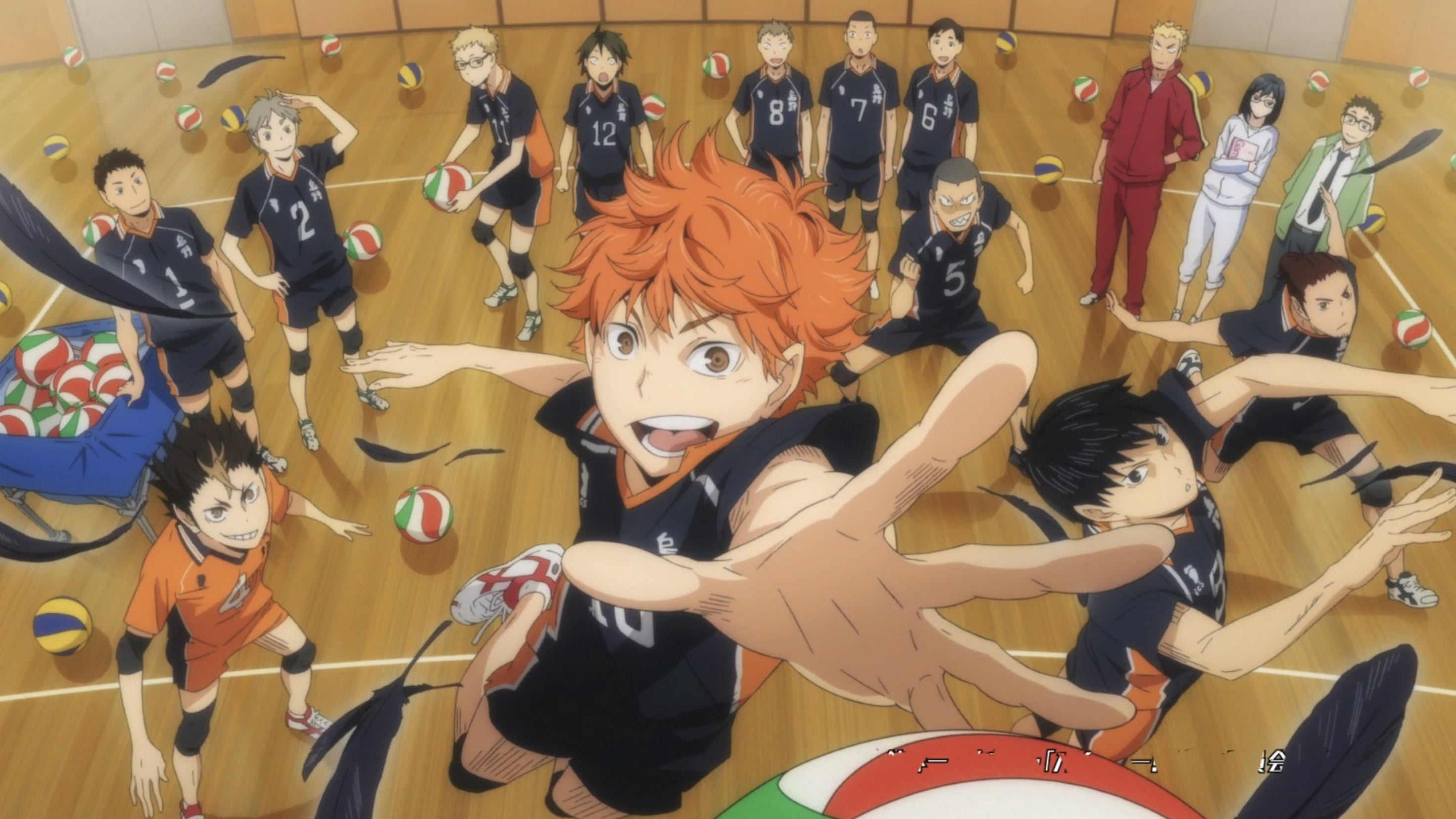 Hinata reaches for the ball as he is surrounded by the Karasuno High School boys' volleyball team