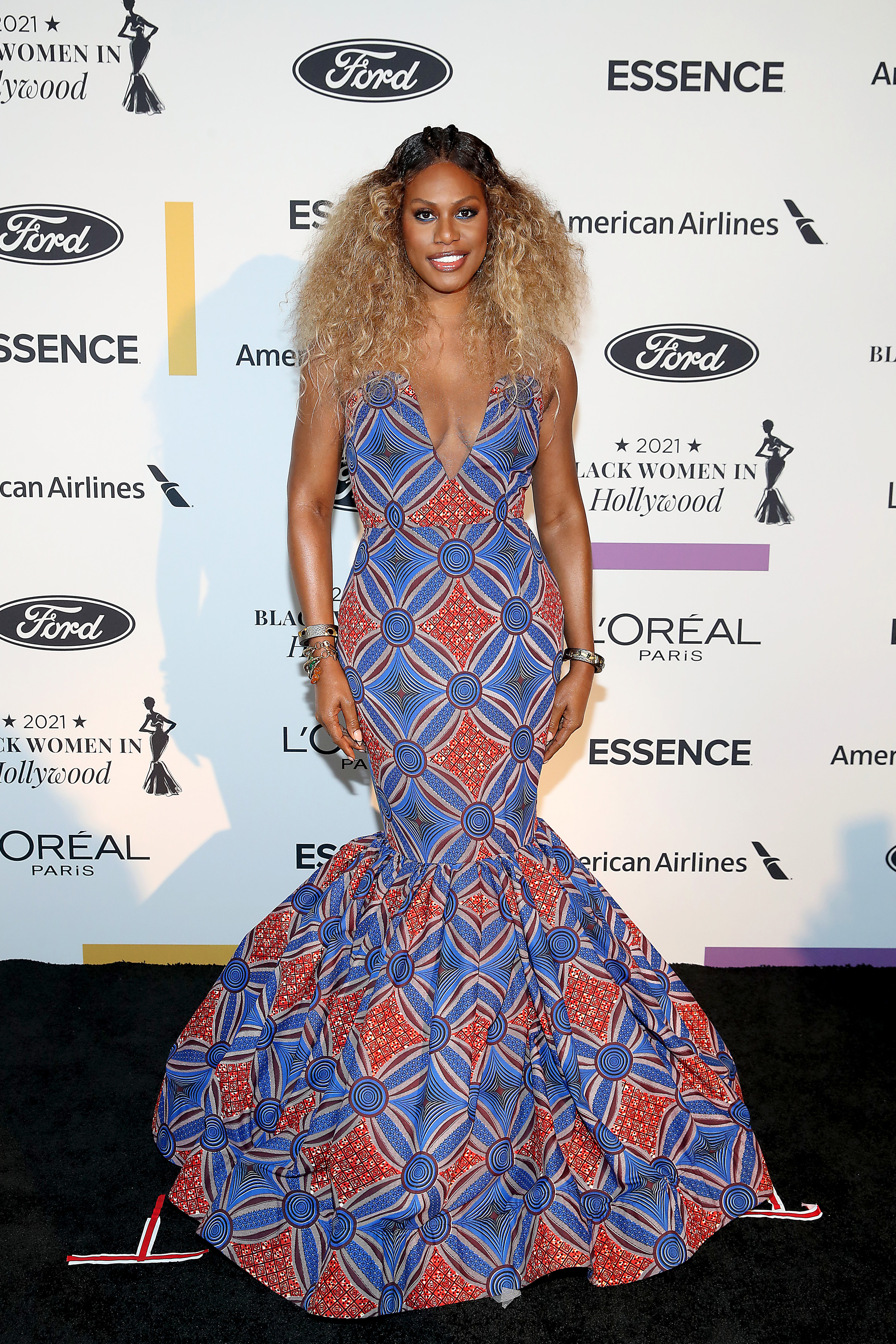 Laverne wears a blue and red geometric mermaid gown