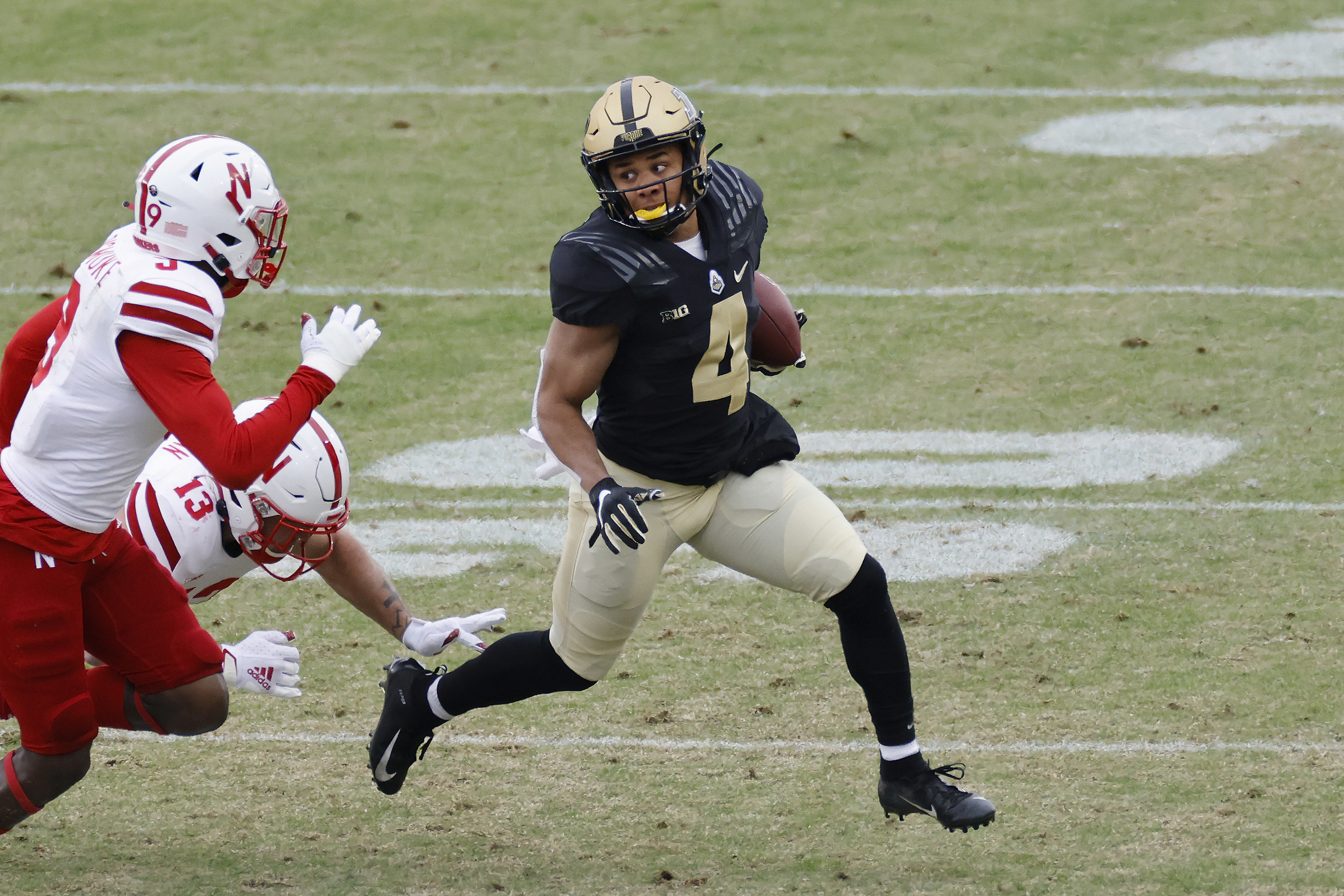 Rondale Moore running away from tacklers