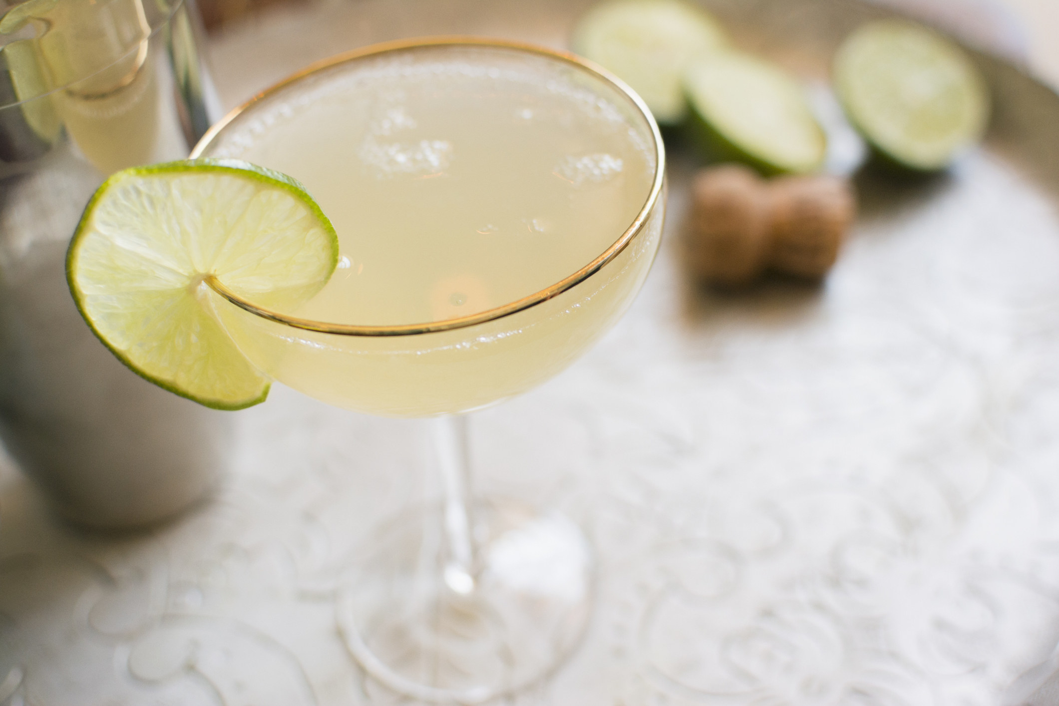 A lime daiquiri in a coupe.