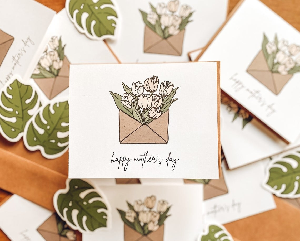 A card with an illustration of a bouquet of flowers coming out of an envelope
