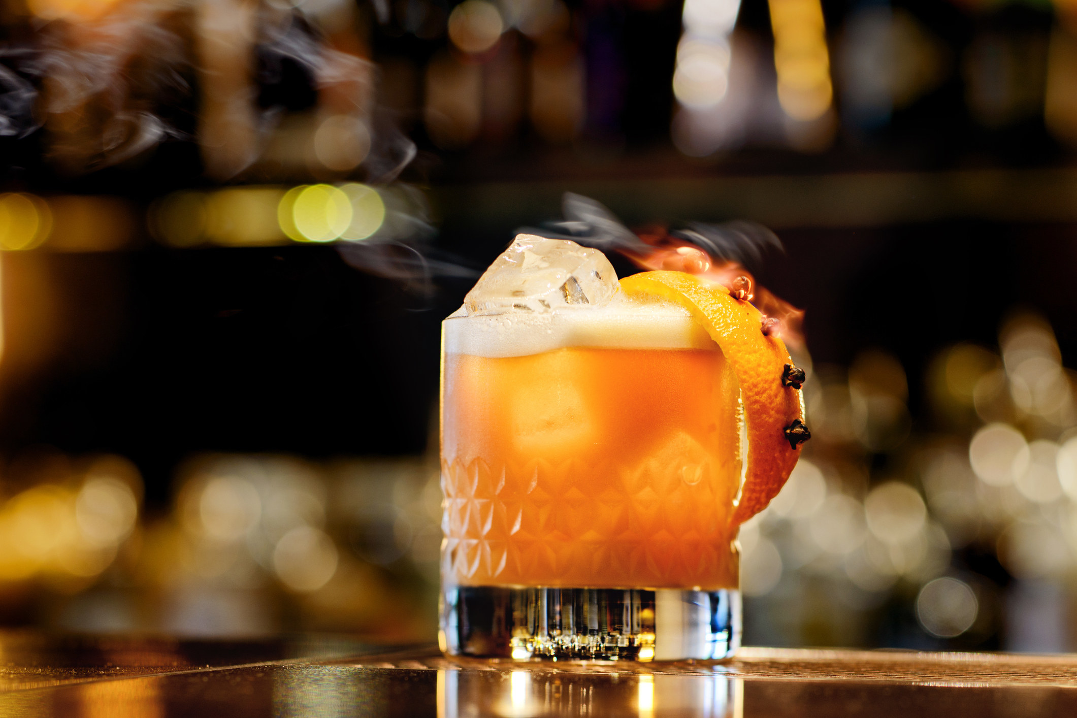 A whiskey sour on a cocktail bar.