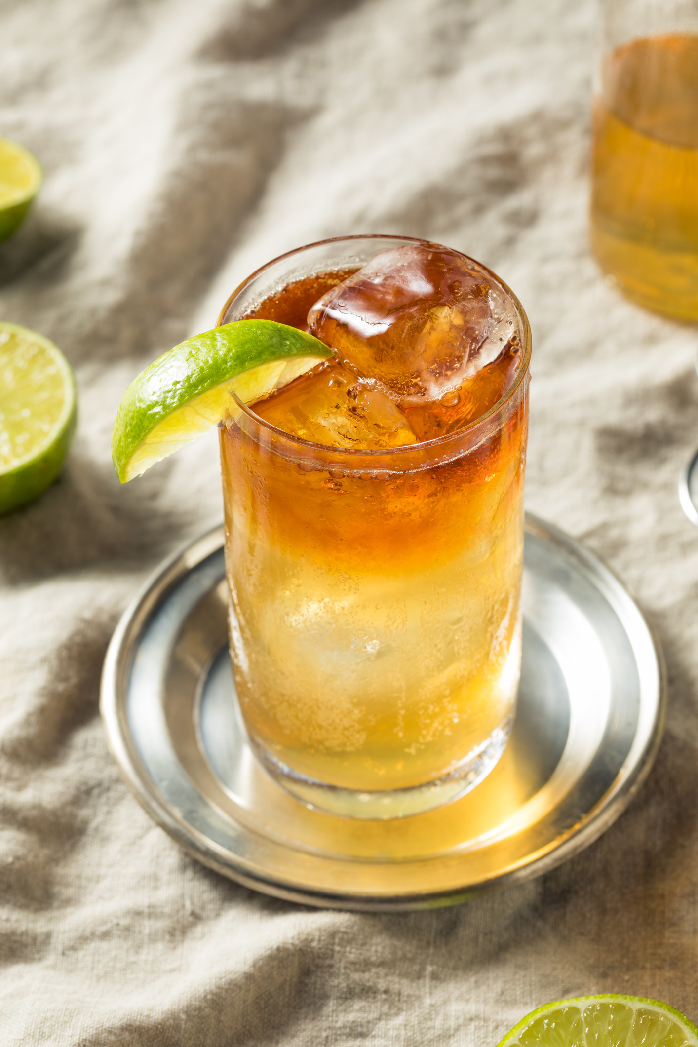 A dark and stormy cocktail with lime.