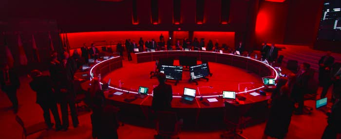 The government meeting room is lit with red lights